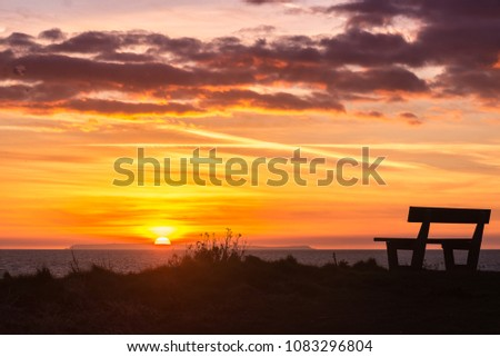 Beautiful Sunset over Lundy Island from Woolacombe North Devon Royalty-Free Stock Photo #1083296804
