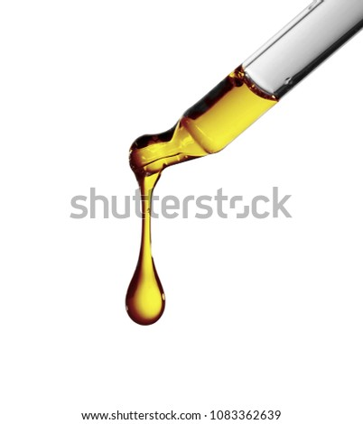 Petroleum oil dropping from glass dropper in the laboratory lab #1083362639