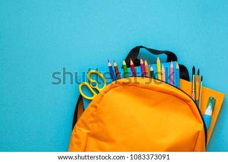 Back to school concept. Backpack with school supplies. Top view. Copy space Royalty-Free Stock Photo #1083373091