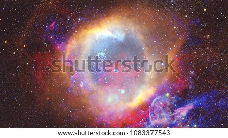 Colored nebula and open cluster of stars in the universe. Elements of this image furnished by NASA. Royalty-Free Stock Photo #1083377543