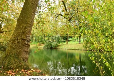 Poissy, France - october 29 2017 : the Meissonier park in autumn #1083518348