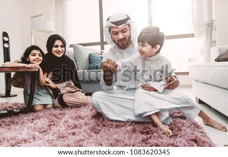 Arabic happy family lifestyle moments at home #1083620345