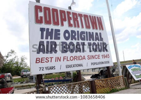 Everglades, FL / USA; April 27, 2018; The Coopertown Air Boat Tour sign is pictured in a Everglades National Park. #1083658406