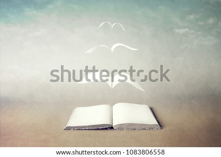 surreal book concept pages flying out of book Royalty-Free Stock Photo #1083806558