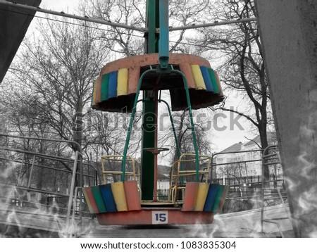 Abandoned Ferris wheel.           #1083835304