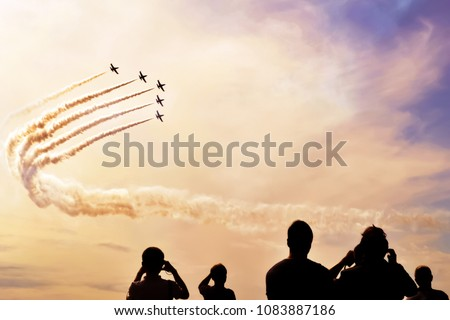 A group of professional pilots of military aircraft shows tricks in the evening sky, leaving beautiful traces of clouds. International Aviation and Space Salon, MAKS. Zhukovsky, Moscow Region, Russia. #1083887186