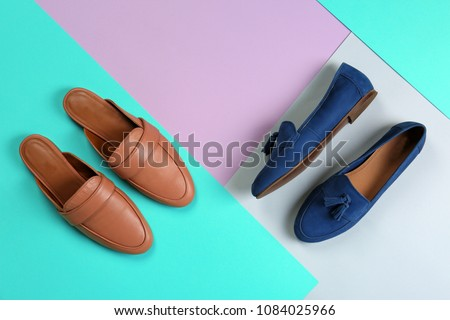 Different female shoes on color background, top view #1084025966