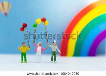 Miniature family: Children holding balloon. Image use for international children's day. #1084049960