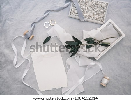 Wedding invitation card with decorations on linen background. Rustic Wedding  Overhead view. Flat lay, top view wedding invitation card Templates