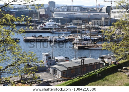 Oslo harbour with docked boats. #1084210580