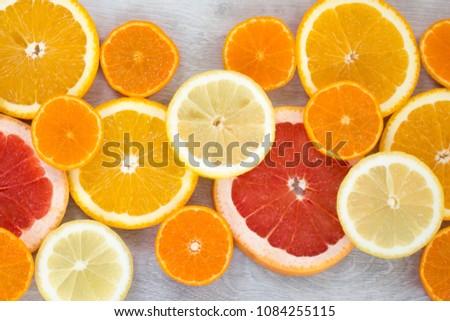 Sliced juicy orange, lemon, grapefruit and mandarin background #1084255115