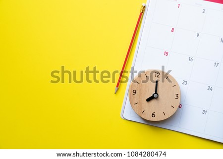 close up of calendar or monthly planner on the yellow background, planning for business meeting or travel planning concept #1084280474