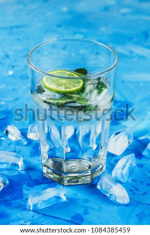 lemonade or a cocktail of citrus with mint and ice #1084385459