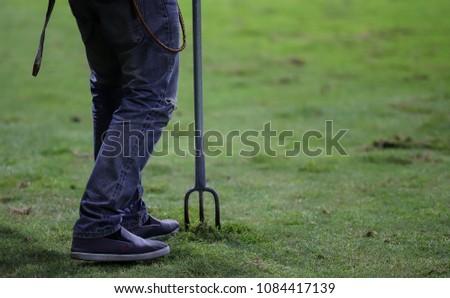 Lawn care man in the thai football field. #1084417139