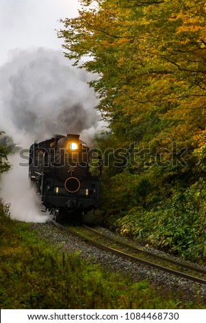 steam locomotive in autumn forest at Fukushima Japan #1084468730