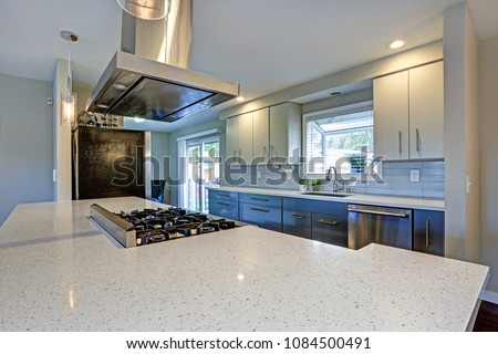 Stylishly updated kitchen with quartz countertops and stainless steel appliances.  #1084500491