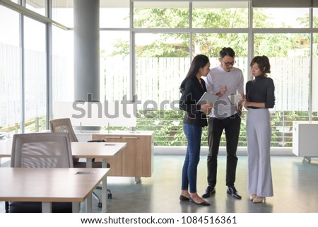 young asian business people ,man and woman, working with team in startup office, copyspace #1084516361