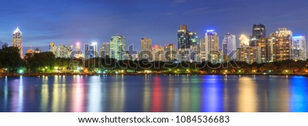 Panorama Lake view with reflections of the city / high building in the city lake view #1084536683