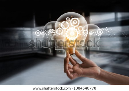 Hand holding light bulb and cog inside. Idea and imagination. Creative and inspiration. Innovation gears icon with network connection on metal texture background. Innovative technology industrial. #1084540778