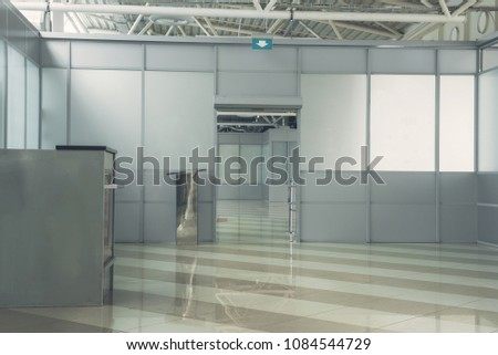 Interior of modern empty building inside with exit in hall. Industry concept #1084544729