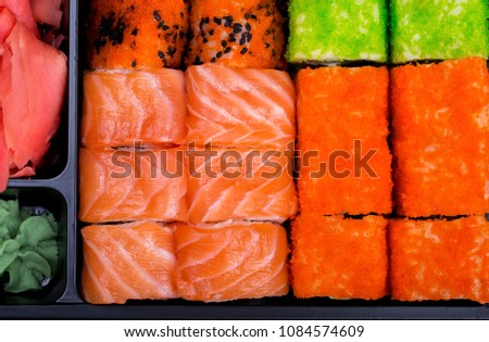 Big sushi set in black plate on black background/ top view close up macro shoot  #1084574609
