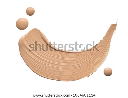Light beige makeup smear of creamy foundation isolated on white background. Light beige creamy foundation texture isolated on white background #1084601114