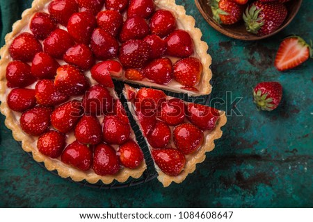 slice of delicious strawberry tart on green background, top view #1084608647