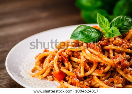 Pasta with meat, tomato sauce and vegetables  #1084624817