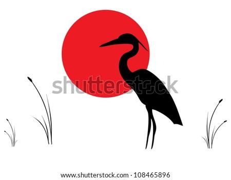 silhouette of crane against rising sun