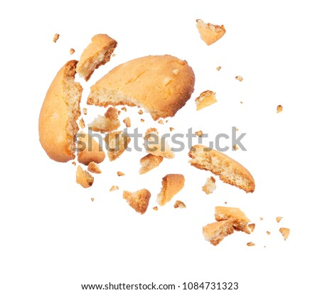 Biscuits crumbles into pieces close-up isolated on a white background Royalty-Free Stock Photo #1084731323