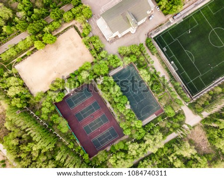 aerial view of summer sport camp courts and building in the forest