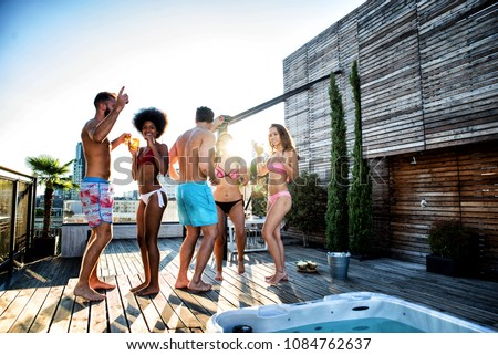 Multi-ethnic group of friends having party on  rooftop - Happy people bonding and having fun #1084762637