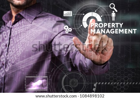 Business, Technology, Internet and network concept. Young businessman working on a virtual screen of the future and sees the inscription: Property management #1084898102