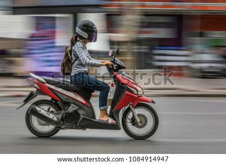 Chiang Mai, Thailand, May 2018 - Panning commuter on the street. #1084914947
