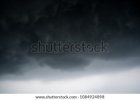 dark storm clouds with background,Dark clouds before a thunder-storm. #1084924898