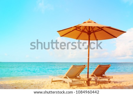 Two beach chairs on tropical vacation #1084960442