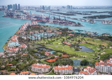 Aerial view of Fisher Island and Miami skyline, Florida - USA #1084976204