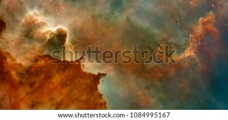 Hubble image of the  Eagle Nebulaas Pillars of the Creation. Elements of this image furnished by NASA. Royalty-Free Stock Photo #1084995167