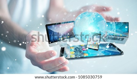 Businessman connecting tech devices and icons applications with each other 3D rendering #1085030759