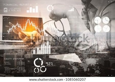 Financial report data of business operations (balance sheet and  income statement and diagram) as Fintech concept.Double exposure of success businessman using eyeglass and digital tablet. #1085060207