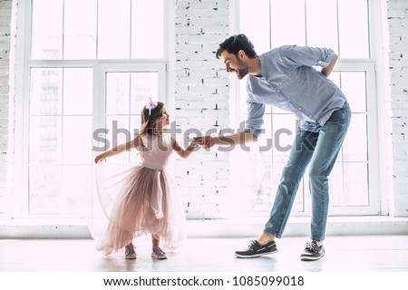 I love you, dad! Handsome young man is dancing at home with his little cute girl. Happy Father's Day! Royalty-Free Stock Photo #1085099018