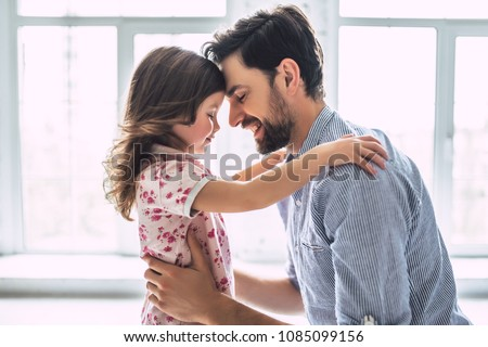 I love you, dad! Handsome young man at home with his little cute girl. Happy Father's Day! Royalty-Free Stock Photo #1085099156