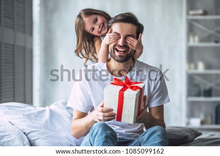 I love you, dad! Handsome young man at home with his little cute girl. Happy Father's Day! Royalty-Free Stock Photo #1085099162
