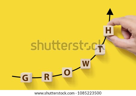 Business success growing growth increase up concept. Wooded cube block on white background with word GROWTH and copy space for your text #1085223500