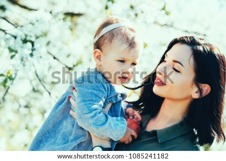 Happy loving family mom and child girl kissing and hugging outdoor in blossom park. Mother day, Relationship Love Values Tenderness Lifestyle #1085241182