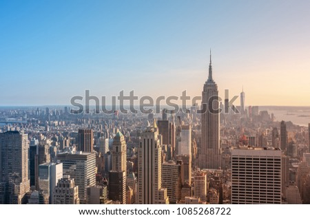New York City skyline and urban skyscrapers at sunset #1085268722