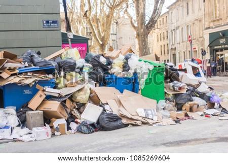 Avignon, France - 13 february 2018 : full garbage bins and trash dump in the street of Avignon. #1085269604
