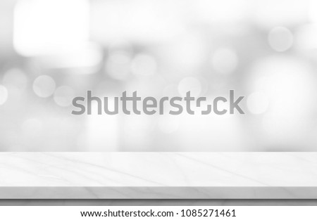 Empty white marble over blur background, for your photo montage or product display, Space for placing items on the table, product and food display.  #1085271461