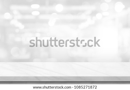 Empty white marble over blur background, for your photo montage or product display, Space for placing items on the table, product and food display.  #1085271872