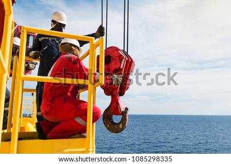 Crane inspector, crane inspector on the job inspec crane operation system,crane equipment and fucntion pull load test by load cell calibrator #1085298335